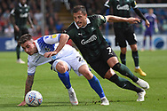 Michael Kelly (28) of Bristol Rovers battles with Antoni Sarcevic (7) of Plymouth Argyle during the EFL Sky Bet League 1 match between Bristol Rovers and Plymouth Argyle at the Memorial Stadium, Bristol, England on 8 September 2018.