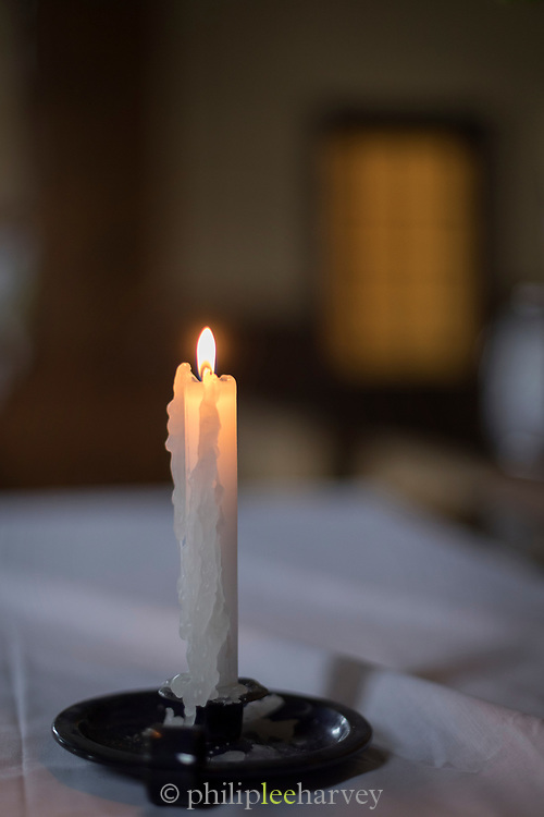 Candle burning in Vilupulli Church on Chiloe Island, Chile