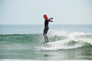 A surf hangs ten in Virginia Beach, VA.