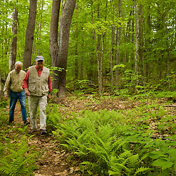York Land Trust members walk a woodland trail at Highland Farm in York, Maine.