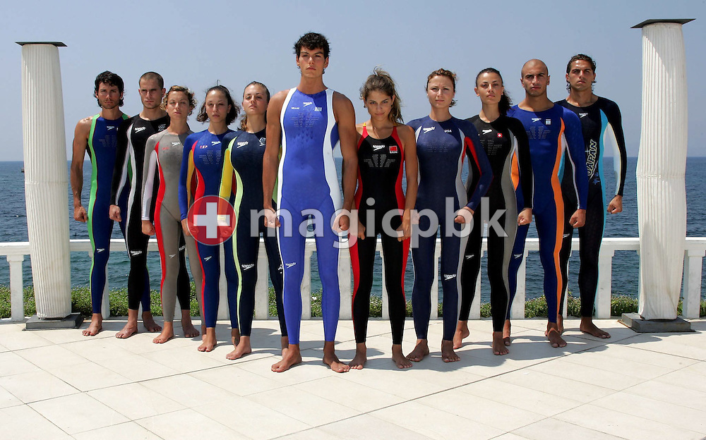 Models present the swimsuits of the olympic swimming teams of (from left) South Africa, New Zealand,  Austria, Spain, Australia, Greece, China, United States, Switzerland, Netherlands and Japan during a photocall at the Olympic Games 2004 in Athens, Monday 09 August 2004.  (Photo by Patrick B. Kraemer / MAGICPBK)