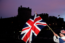 A royal fan waves a Union flag in Windsor ahead of the wedding of Princess Eugenie to Jack Brooksbank at St George's Chapel in Windsor Castle.