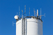 Cellular and mobile radio communications antennas on water tower in Chinchilla, Queensland, Australia <br /> <br /> Editions:- Open Edition Print / Stock Image