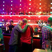 GLASGOW, SCOTLAND - OCTOBER 09, 2016: A gay couple kisses at the bar in Delmonicas, a popular gay venue in central Glasgow. CREDIT: Paulo Nunes dos Santos for The New York Times