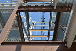 View up at West Elevation through floors. Central Connecticut State University. New Academic Building. Project No: BI-RC-324. Architect: Burt Hill Kosar Rittelmann Associates. Contractor: Gilbane, Inc.