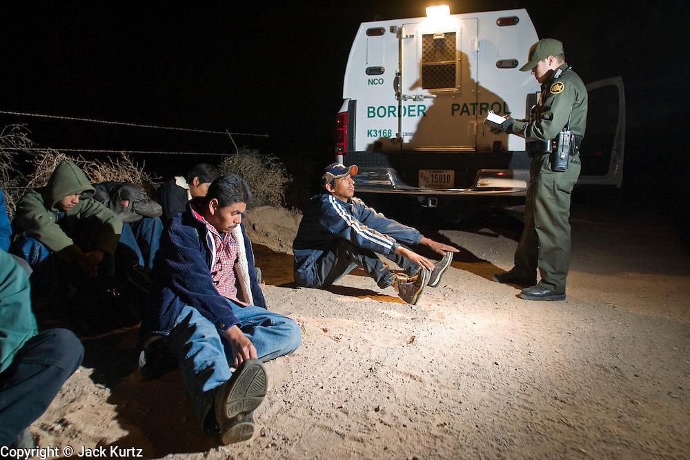 30 MARCH 2004 -- DOUGLAS, AZ: A Border Patrol agent processes a group of undocumented immigrants apprehended near Douglas, AZ. PHOTO BY JACK KURTZ