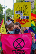 People some of them wearing face masks, hold placards and banners as they attend a 'crime scene' investigation unit of Extinction Rebellion, who through a form of performative crime scene protests are seeking to step up pressure on Shell and demand an end on fossil fuel extraction as well as ecocide, outside SHell Headquarters in Jubilee Gardens, central London on Tuesday, Sept 8, 2020. Environmental nonviolent activists group Extinction Rebellion enters its 8th day of continuous ten days protests to disrupt political institutions throughout peaceful actions swarming central London into a standoff, demanding that central government obeys and delivers Climate Emergency bill. (VXP Photo/ Vudi Xhymshiti)