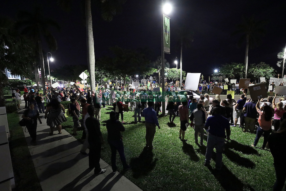 November 11, 2016 - Florida, U.S. - A large crowd protests against the election of Donald Trump as the 45th President of the United States Friday, November 11, 2016 in front of the luxury condominium towers that bear his name along the waterfront in West Palm Beach, FL.  Damon Higgins / The Palm Beach Post (Credit Image: © Damon Higgins/The Palm Beach Post via ZUMA Wire)