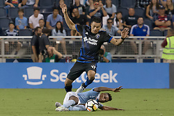 August 9, 2017 - Kansas City, Kansas, U.S - San Jose Earthquakes midfielder Darwin Ceren #17 (above) will receive a yellow card for an illegal tackle against Sporting KC forward Latif Blessing #9 (below) during the first half of the game. (Credit Image: © Serena S.Y. Hsu via ZUMA Wire)