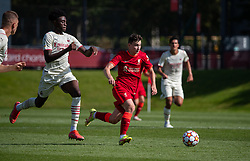 LIVERPOOL, ENGLAND - Wednesday, September 15, 2021: Liverpool's Mateusz Musialowski (R) gets away from AC Milan's Nosa Edward Obaretin during the UEFA Youth League Group B Matchday 1 game between Liverpool FC Under19's and AC Milan Under 19's at the Liverpool Academy. Liverpool won 1-0. (Pic by David Rawcliffe/Propaganda)