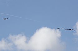 © Licensed to London News Pictures. 21/08/2018. Epsom, UK. A light aircraft carries a message over the funeral of traveller Mikey Connors at Epsom cemetery. 32 year-old Mikey Connors, the nephew of My Big Fat Gypsy Wedding star Paddy Doherty, was killed when his horse-and-cart was hit by a car in Thamesmead on July 28. Photo credit: Peter Macdiarmid/LNP