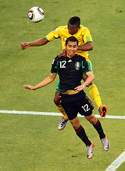 Mexico's Paul Aguilar vs South Africa's Kagisho Dikgacoi during the Group A first round 2010 FIFA World Cup South Africa match between South Africa and Mexico at Soccer City Stadium on June 11, 2010 in Johannesburg, South Africa.  (Photo by Vid Ponikvar / Sportida)