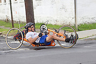 Middletown, New York - A racer on a hand cycle turns onto Fulton Street during the 2012 Run 4 Downtown road race on Saturday, Aug. 18, 2012.
