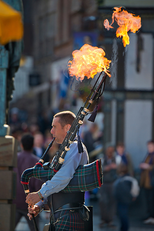 Street vendor plays fire breathing bagpipes in Edinburgh, Scotland
