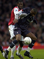 Photo: Olly Greenwood.<br />Arsenal v Bolton Wanderers. The FA Cup. 28/01/2007. Bolton's Abdoulaye Meite and Arsenal's Emmanuel Adebayor