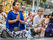 21 AUGUST 2015 - BANGKOK, THAILAND: People gather on the plaza at Erawan Shrine for a Mahayana Buddhist ceremony to restore the shrine after the bombing. The Bangkok Metropolitan Administration (BMA) held a religious ceremony Friday for the Ratchaprasong bomb victims. The ceremony started with a Brahmin blessing at Erawan Shrine, which was the target of a bombing Monday night. After the blessing people went across the street to the plaza in front of Central World mall for an interfaith religious service. Theravada Buddhists, Mahayana Buddhists, Muslims, Sikhs, Hindus, and Christians participated in the service. Life at the shrine, one of the busiest in Bangkok, is returning to normal. Friday the dancers and musicians who perform at the shrine resumed their schedules.      PHOTO BY JACK KURTZ