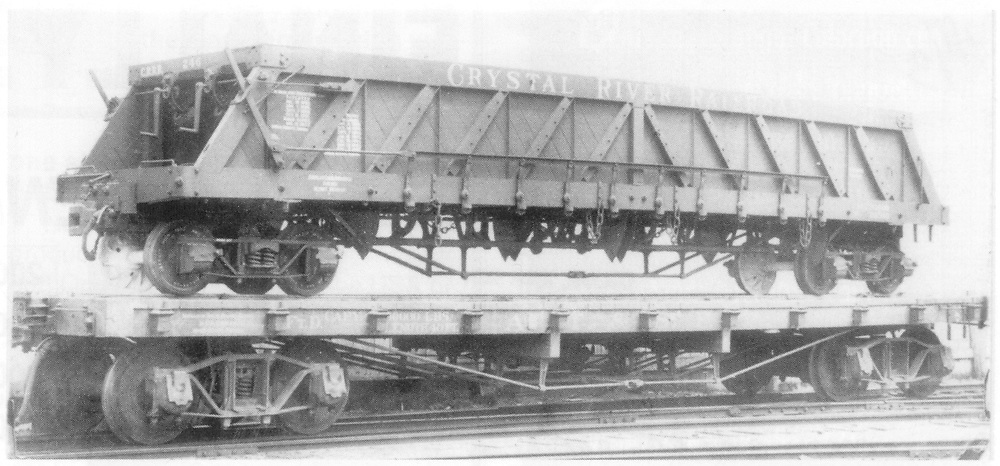 """3/4 view of Crystal River Railroad Ingoldsby Patent Dump Car gondola #246 on an AT&SF standard gauge flatcar at Detroit, MI.  Apparently the gondola is being transported from AC&F to the CRR.<br /> Crystal River Railroad  Detroit, MI  1902<br /> In book """"Century + Ten of D&RGW Narrow Gauge Freight Cars, 1871-1981, A (1st ed.)"""" page 164<br /> The 2nd edition of Sloan's book has this picture on p. 181."""