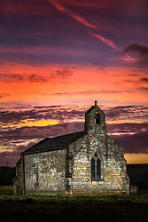 © Licensed to London News Pictures. 20/01/2020. Lead UK. The sky turns pink & red behind St Mary's church in North Yorkshire at dawn this morning. The fourteenth century church sits alone in a field that was once the site of the medieval village of Lead, inside the church monuments to crusading Knights can be found. The grade II listed building was saved from neglect by a local Rambling group in 1931 & is now looked after by the Churches Conservation Trust. Photo credit: Andrew McCaren/LNP