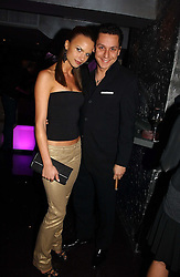 NICK GOLD and NATHALIE BOMGREN at a party to celebrate the opening of Kitts nightclub, 7-12 Sloane Square, London on 7th December 2006.<br /><br />NON EXCLUSIVE - WORLD RIGHTS