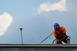 Roof worker, beam, drill and sky. Construction Activity Detail, Central Connecticut State University, New Academic Building.