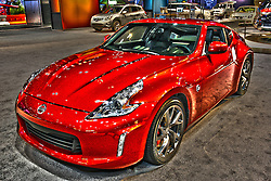 08 February 2012: 2012 NISSAN 370Z: For 2012, the Nissan 370Z Coupe and Roadster remain two of the most vibrant and dynamic rear-wheel drive sports cars available in North America. The 370Z Coupe is again available in three models, 370Z Coupe and 370Z Coupe Touring and the NISMO 370Z, which features unique performance and design attributes. If you prefer drop-top driving, the 2012 Roadster is offered in two models: 370Z Roadster and 370Z Touring Roadster. There are no major specification or equipment changes for the 2012 model year. All standard Coupe and Roadster models feature a 3.7-liter DOHC V6 engine that creates 332 horsepower and 270 lb. ft. of torque and choice of six-speed manual transmission with an available SynchroRev Match synchronized downshift rev matching system or a seven-speed automatic transmission with paddle shifters. Step-up to the limited production NISMO 370Z, and receive the same V6, but with exclusive H-configured exhaust system, 350hp and 276 lb. ft. of torque, and NISMO-tuned suspension. Unique Z packages available for the two-passenger cockpit include Nissan Intelligent Key with push button ignition, heating and cooling ventilated net seats, Bluetooth hands-free phone system, satellite radio and advanced Nissan Navigation System.  Chicago Auto Show, Chicago Automobile Trade Association (CATA), McCormick Place, Chicago Illinois<br /> <br /> This image was produced in part utilizing High Dynamic Range (HDR) or panoramic stitching or other computer software manipulation processes. It should not be used editorially without being listed as an illustration or with a disclaimer. It may or may not be an accurate representation of the scene as originally photographed and the finished image is the creation of the photographer.