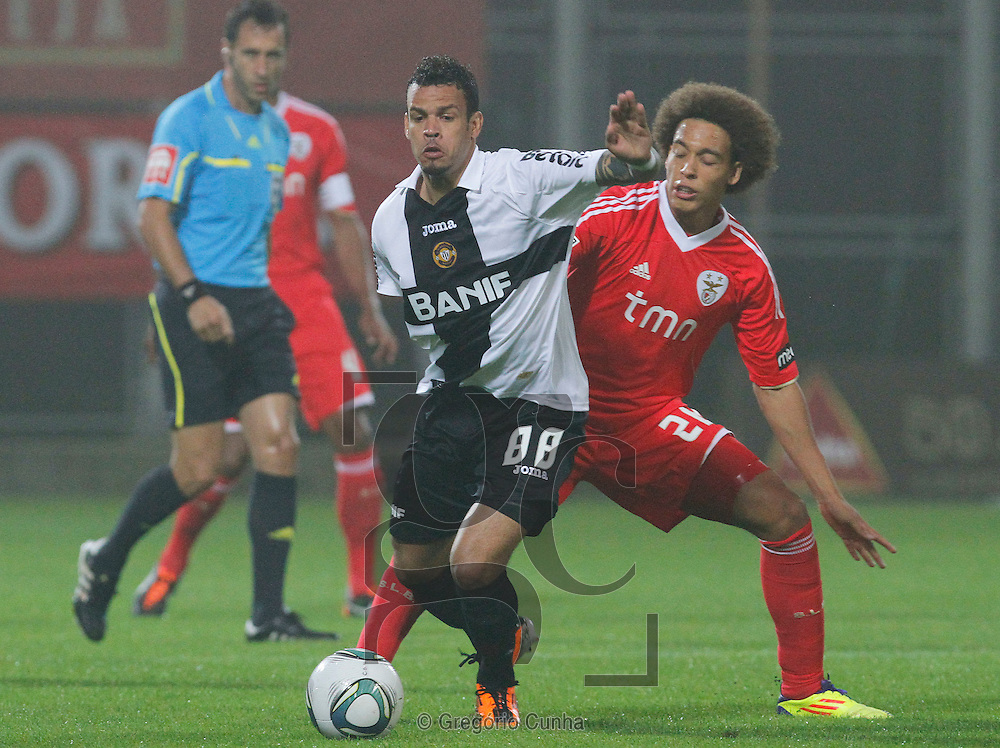 Portugal, Funchal, Madeira : Nacional's midfielder Luis Alberto (L) vies with Benfica's midfielder Axel Witsel (R) during the Portuguese league football match Nacional Madeira vs Benfica on August 29, 2011 at the Madeira Stadium in Funchal. .PHOTO / GREGORIO CUNHA