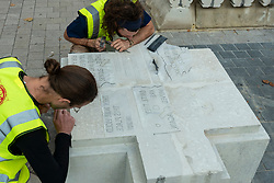 © Licensed to London News Pictures. 17/09/2021. LONDON, UK. Stonemasons work on 'Placeholders' by Juliet Haysom and Aude-Line Duliere, an exercise in the circular economy, which reuse of the Aston Webb Screen stones from the V&A musuem as urban furniture on Exhibition Road. Launch of this year's London Design Festival at the V&A Museum in South Kensington.  Installations, projects, performances and events explore design thinking in the challenge of climate change. Photo credit: Stephen Chung/LNP