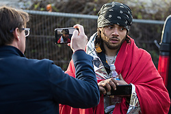 Harefield, UK. 16 January, 2020. Stop HS2 activist Freeman is interviewed by Jason Farrell of Sky News following his eviction from the Harvil Road wildlife protection camp in the Colne Valley after over two days and two nights taking refuge in a tree in woodland. 108 ancient woodlands are set to be destroyed by the high-speed rail link and further destruction of trees for HS2 in the Harvil Road area is believed to be imminent.
