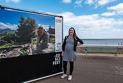 Edinburgh Science Festival, Edinburgh, Scotland, United Kingdom: <br /> Pictured: Emily Raemaekers, Curator of the exhibition, with one of the photos in the exhibition.<br /> The 2021 Edinburgh Science Festival (26 June – 11 July) focuses on the climate challenges and opportunities ahead and the first of its events opens today with a free outdoor photographic exhibition called Human Nature. The exhibition is a photographic journey around the world to show how we connect to nature, and features work of critically acclaimed photographers, including Lucas Foglia whose photographs  feature in National Geographic and New York Times and Anna Deacon, Edinburgh-based photographer and author known for portraits of wild swimmers.<br /> Sally Anderson | EdinburghElitemedia.co.uk