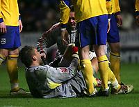 Photo: Andrew Unwin.<br />Newcastle United v Southampton. The FA Cup. 18/02/2006.<br />Southampton's goalkeeper, Bartosz Bialkowski, receives treatment.