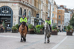 © Licensed to London News Pictures. 23/11/2020. London, UK. Mounted Police patrol a quiet Covent Garden in London as office workers stay away from the City. Prime Minister Boris Johnson will address the Nation tonight to set out his plans for Christmas and the end of lockdown 2.0 with the opening up of shops and restaurants. However he will also introduce a new tougher three-tiered system with further localised restriction to the hospitality industry, Christmas office parties and pub opening hours. Photo credit: Alex Lentati/LNP