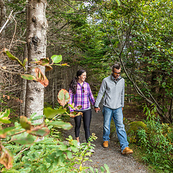 A couple walks on a trail at Quoddy Head State Park in Lubec, Maine.