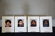 Photographs of suspects arrested for the murder of Mohammad Reza Sadeghzadeh, a 67-year-old Milpitas 7-Eleven night clerk who was murdered on September 8, 2012 during a 2:13 a.m. robbery, are displayed during a press conference at the Milpitas Police Department in Milpitas, California, on December 12, 2013.  The suspects include Jerry Coneal, Warner Travis, Delmon Armstead, and Bianca Barrow. (Stan Olszewski/SOSKIphoto)