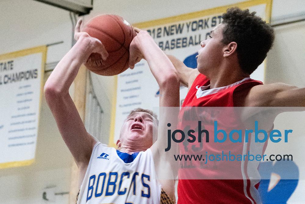 Lansing's Ethan Burt, Newark Valley's Donavin Anderson-Beebe during the game at Lansing High School on Thursday, December 20, 2018 in Lansing, New York. (Photo/Josh Barber)