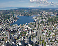 Low oblique territorial aerial view of Lake Union and surrounding Seattle neighborhoods, looking north along I-5.