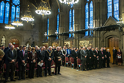 © Licensed to London News Pictures. 05/01/2018. Manchester, UK. A minute's silence is held in memory of the victims . Police officers and railway workers who came to the aid of victims in the wake of the terrorist attack at an Arina Grande concert at the Manchester Arena in May 2017 are honoured at a commendation ceremony at the Great Hall at Manchester Town Hall. Amongst those honoured are officers from British Transport Police and Northern Rail staff . Photo credit: Joel Goodman/LNP