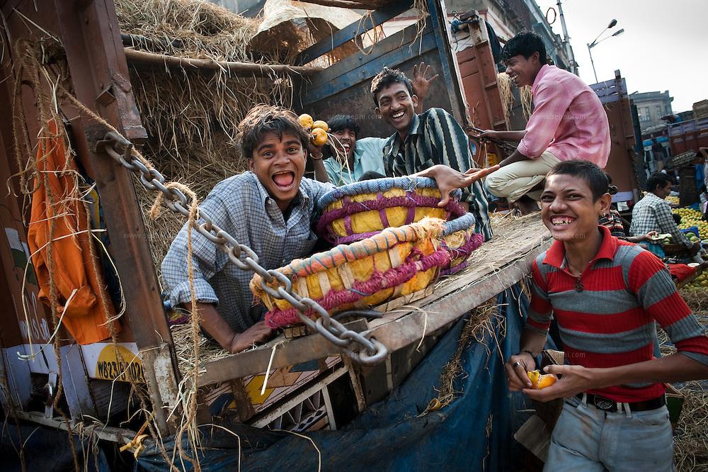 Kids are playing at Kolkata fruit market.