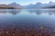 Standup paddleboarding on Lake McDonald in Glacier National Park, Montana, USA MR