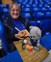 A Chelsea fan with a mascot and a mini picnic before the Carabao Cup, Third Round match at Stamford Bridge, London.