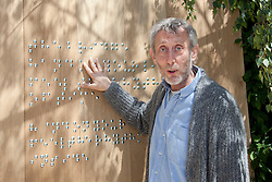 © licensed to London News Pictures. LONDON, UK  23/05/2011. Chelsea Flower Show, Press Day.  Please see special instructions for usage rates. Michael Rosen with his braille artwork in the RNIB Garden. Photo credit should read Bettina Strenske/LNP