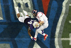 Dec 31, 2014; Atlanta , GA, USA; TCU Horned Frogs linebacker Marcus Mallet (54) hits Mississippi Rebels quarterback Bo Wallace during the second quarter in the 2014 Peach Bowl at the Georgia Dome. Mandatory Credit: Kevin Liles/CFA Peach Bowl via USA TODAY Sports