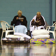 Beverley Fox, 86, and her husband Desmond Fox, 87, enjoy a meal as they rest at the Crowles Stadium in Christchurch used to shelter earthquake victims, their property was damaged when a Powerful earth quake ripped through Christchurch, New Zealand on Tuesday lunch time killing at least 65 people as it brought down buildings, buckled roads and damaged houses, churches and the Cities Cathedral. 23rd February 2011.  Photo Tim Clayton