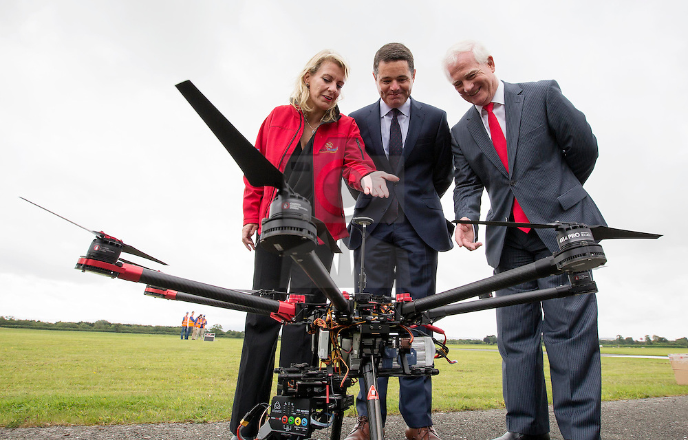 Repro Free: 21/08/2015<br /> Capt. Julie Garland, Chairperson, UAAI is pictured with Mr Paschal Donoghue T.D. Minister for Transport, Tourism and Sport and Ralph James, Director of Safety Regulation, Irish Aviation Authority (IAA) at the inaugural Unmanned Aircraft Association of Ireland (UAAI) 'Meet the Drones' showcase event at Weston Airport in Lucan Co Dublin sponsored by the IAA. Picture Andres Poveda