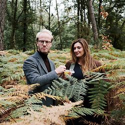 Xavier Desforges from Maison Caulieres is having Claudia Di Paolo tasting their honey while taking a walk in the Huche Grolle woods. Dolus-le-Sec, France. October 7, 2019.