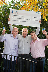 Family Syndicate, Brothers Ian (left) and Mark (right)  and Dad Les Holmes all from Doncaster collect £6,722,094 in National Lottery Win.27 October 2010 .Images © Paul David Drabble