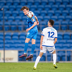 BRISBANE, AUSTRALIA - SEPTEMBER 20: Matthew Schmidt of Gold Coast City heads the ball in front of Stefan Zinni of South Melbourne during the Westfield FFA Cup Quarter Final match between Gold Coast City and South Melbourne on September 20, 2017 in Brisbane, Australia. (Photo by Gold Coast City FC / Patrick Kearney)