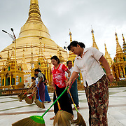 Women brooming Shwedagon pagoda's floor