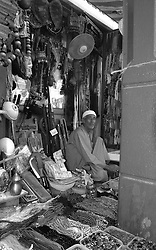 An old man on selling wares at a souk in Dubai, UAE, September 6, 2004. Photo by Silvia Baron / i-Images.