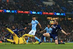16th December 2017 - Premier League - Manchester City v Tottenham Hotspur - Jan Vertonghen of Spurs blocks a cross from reaching Sergio Aguero of Man City and Spurs goalkeeper Hugo Lloris - Photo: Simon Stacpoole / Offside.