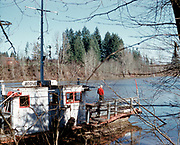 CS00634-02. Boones Ferry, photographed February 1, 1959, after being decommissioned in 1954 when it was replaced by the Baldock Freeway Bridge (now Boone Bridge). The site is Boones Ferry Park in Wilsonville, near Charbonneau.